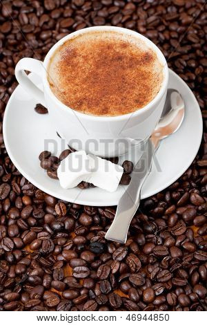 Cup Of Coffee Surrounded By Cofffee Beans