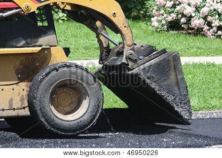 Skid loader with asphalt
