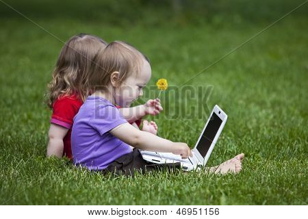 Two Little Children with a Laptop.