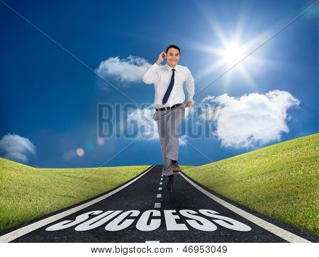 Happy businessman running on the road to success