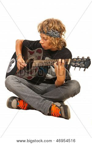 Teen Boy Playing Accoustic Guitar