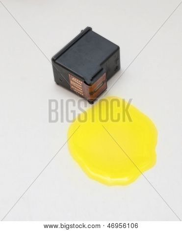 Yellow Ink Cartridge On White Background