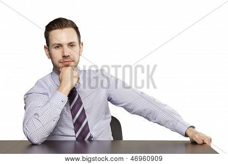 Inviting Business Man Sitting At Table