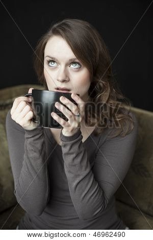 Young Woman With Black Coffee Cup