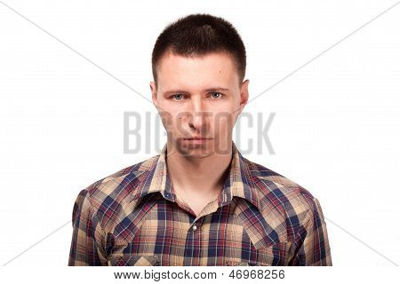 Serious man in a plaid shirt
