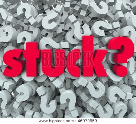The word Stuck on a background of question marks to illustrate being caught in a sticky situation, problem, trouble or issue and thinking of a way out or answer