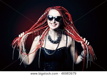 Portrait of expressive girl with great red dreadlocks.