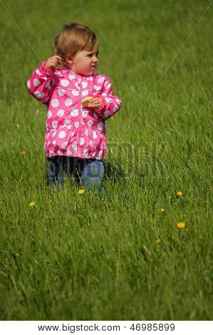 Baby girl in the park on a windy day
