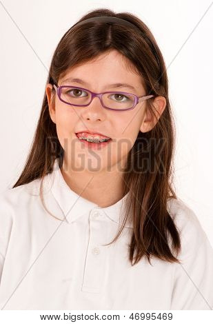 Schoolgirl with glasses and braces
