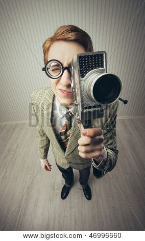 Nerdy Young Man With Movie Camera