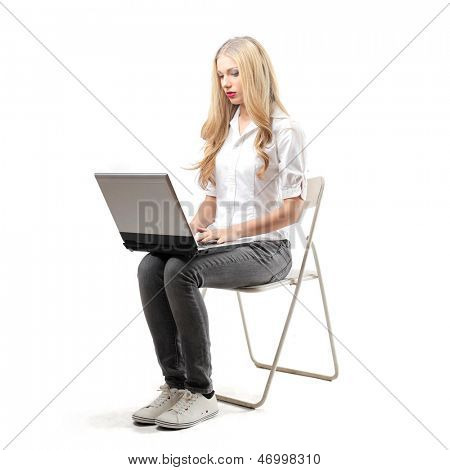 beautiful girl works at the computer