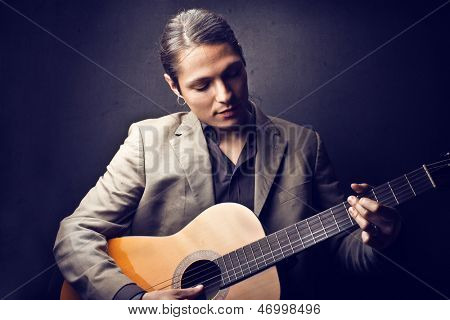 handsome musician playing guitar