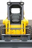 foto of skid-steer  - Skid steer front loader machine at construction site - JPG