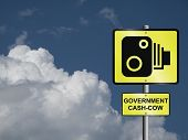picture of cash cow  - Comical government road speed camera sign against a cloudy blue sky - JPG