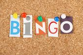 pic of slang  - The word Bingo in cut out magazine letters pinned to a cork notice board - JPG