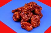 image of chicken wings  - boneless honey bbq chicken wings on the carving board - JPG