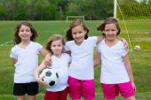 stock photo of little sister  - Soccer football kid girls team at sports outdoor field before match - JPG