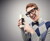 image of nerd  - Nerd student with an old mobile phone - JPG