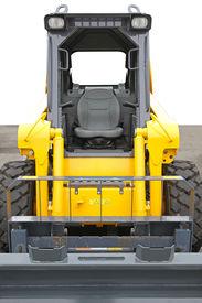 image of skid-steer  - Skid steer front loader machine at construction site - JPG