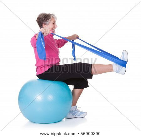 Senior Woman Stretching Exercising Equipment