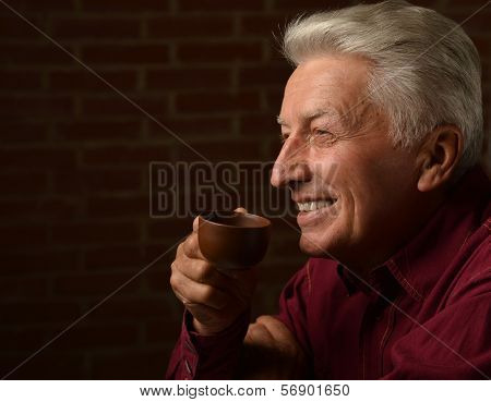 Man with cap of coffee