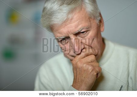 Senior man thinking about something