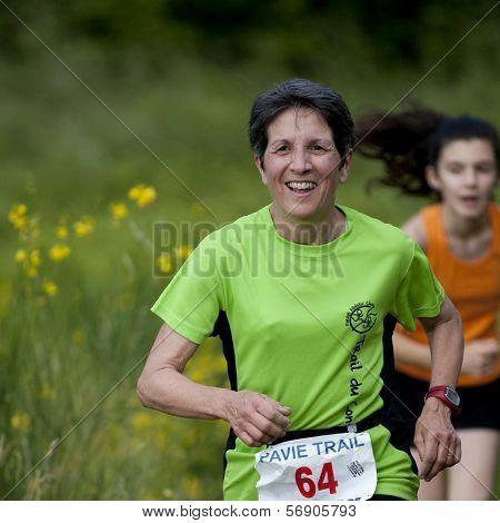 Elderly runner on a path.