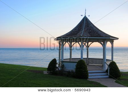 Gazebo by lake at Sunrise
