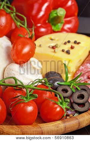 Ingredients for homemade pizza isolated in black