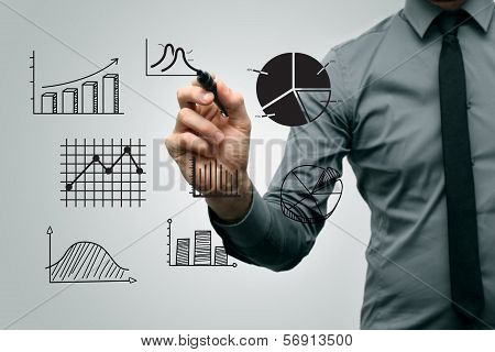 Business Man Drawing Different Graphs And Charts