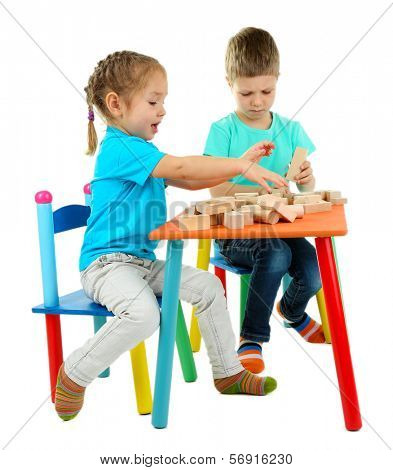 Little children playing with building blocks isolated on white