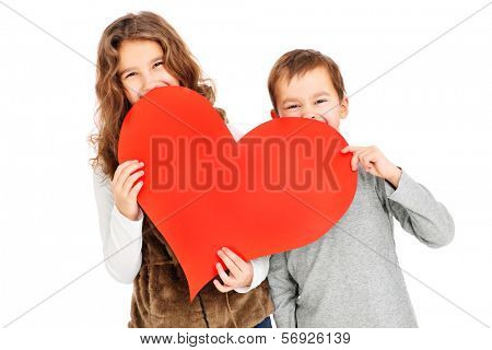 A picture of children holding a red heart over white background