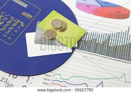 Coins And Credit Cards On A Document With Some Graphics