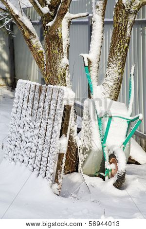 Garden Cart Brought By Snow In The Winter Afternoon