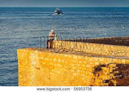 Old Fisherman On The Sea