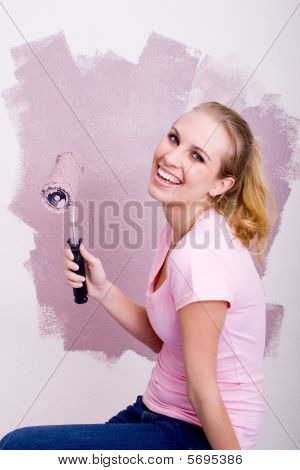 young woman doing home painting