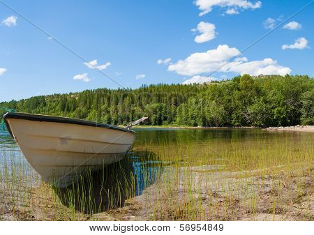 A Boat And Lake In Northern Norway