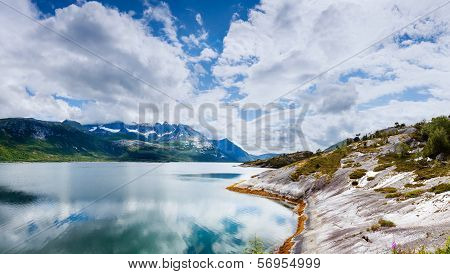 A View Of A Fjord With Reflections Of The Sky In The Water