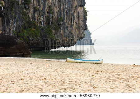 Outrigger Canoe On The Beach