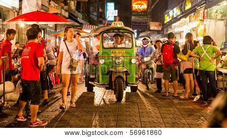 Tuk - tuk on Chinatown street at night