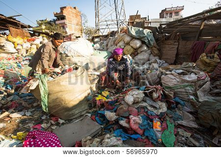 KATHMANDU, NEPAL - DEC 22, 2013: Unidentified people from poorer areas working in sorting of plastic on the dump, Dec 22, 2013 in KTM, Nepal. Only 35% of population have access to adequate sanitation.