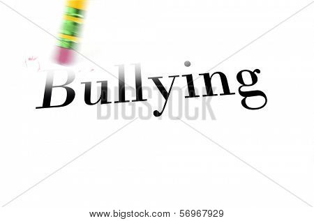 Person using a pencil eraser to erase Bullying from their life so they can start anew