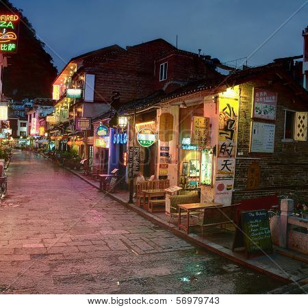 Night Narrow Street In Small Town Yangshuo, Cafes, Restaurants, Hotels.