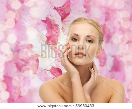 portrait of beautiful woman touching her face skin