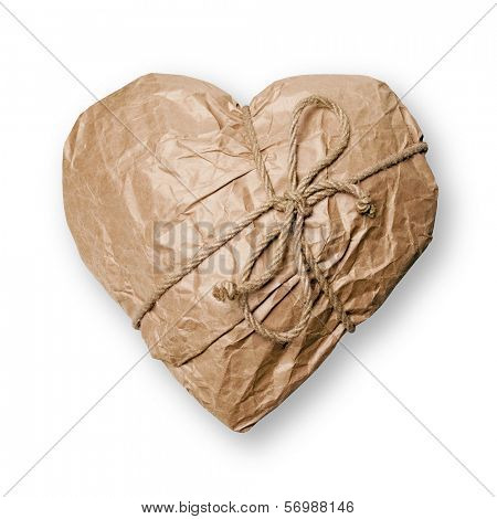Heart packed in brown paper on white background.