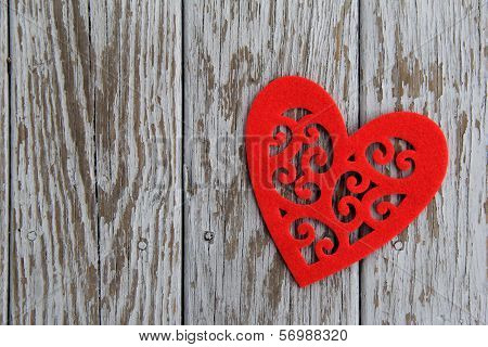 Red,cut-out heart on gray wood