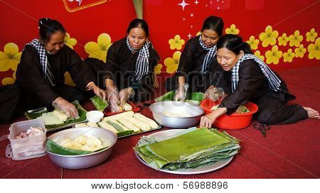 Group Of People Making Traditional Vietnam Food For Tet