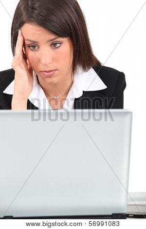 Bored woman in front of computer