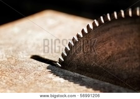 Close-up picture of a rusty circular saw in an old sawmill