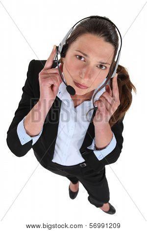 Call-center worker wearing head-set